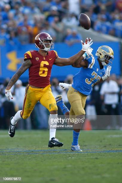 Wide receiver Michael Pittman Jr #6 of the USC Trojans drops a pass as defensive back Quentin Lake of the UCLA Bruins follows during the second half...