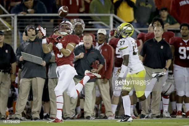 Wide receiver Michael Rector of the Stanford Cardinal catches a 47yard pass in the first quarter against defensive back Terrance Mitchell of the...