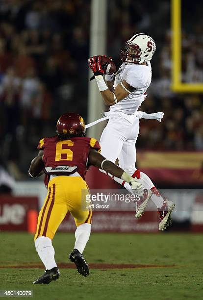 Wide receiver Michael Rector of the Stanford Cardinal makes a reception in front of safety Josh Shaw of the USC Trojans in the second half at Los...