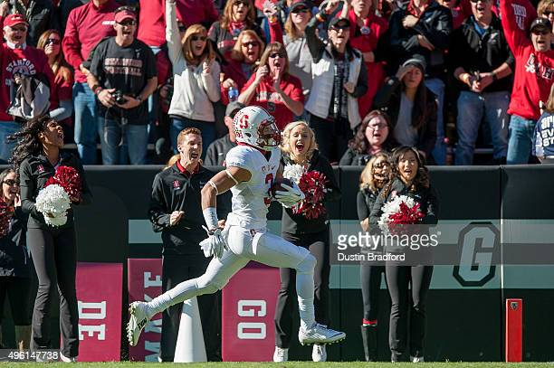 Wide receiver Michael Rector of the Stanford Cardinal scores a receiving touchdown against the Colorado Buffaloes during a game at Folsom Field on...