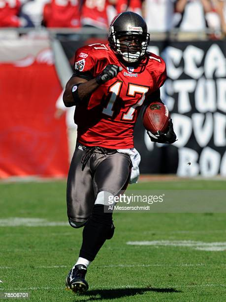 Wide receiver Michael Spurlock of the Tampa Bay Buccaneers returns a kickoff 90yards for a touchdown against the Atlanta Falcons at the Raymond James...