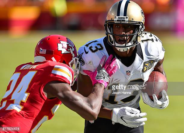 Wide receiver Michael Thomas of the New Orleans Saints begins to be tackled by cornerback D.J. White of the Kansas City Chiefs at Arrowhead Stadium...