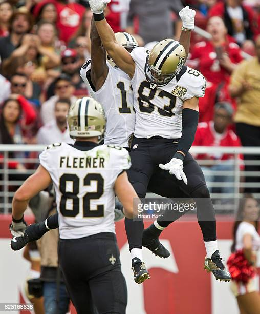 Wide receiver Michael Thomas of the New Orleans Saints celebrates a touchdown with wide receiver Willie Snead IV against the San Francisco 49ers in...