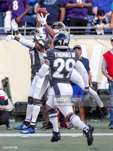 Wide Receiver Michael Thomas of the New Orleans Saints from the NFC Team makes a catch over Cornerback Tre'Davious White of the Buffalo Bills and...