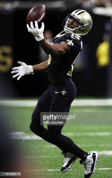 Wide receiver Michael Thomas of the New Orleans Saints makes a catch over the Indianapolis Colts during the game at Mercedes Benz Superdome on...