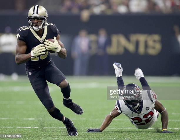 Wide receiver Michael Thomas of the New Orleans Saints moves against the defense of Aaron Colvin of the Houston Texans during the game at Mercedes...