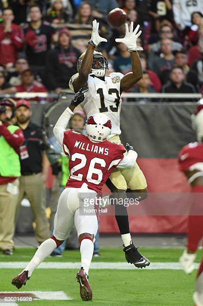 Wide receiver Michael Thomas of the New Orleans Saints scores a four yard touchdown in front of cornerback Brandon Williams of the Arizona Cardinals...