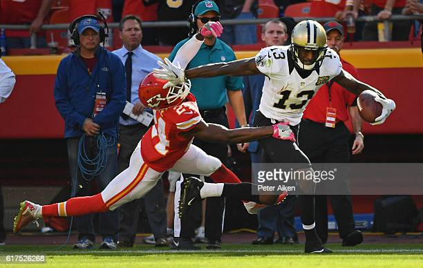 Wide receiver Michael Thomas of the New Orleans Saints stiff arms defensive back D.J. White of the Kansas City Chiefs during the second half on...