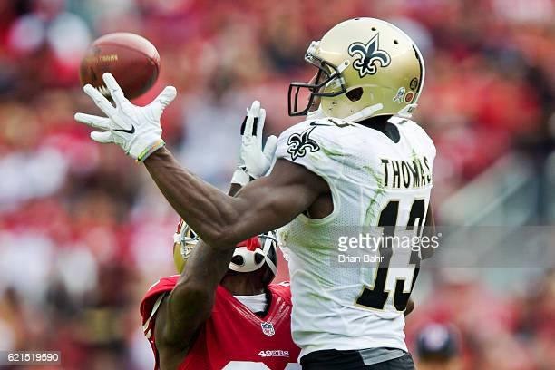 Wide receiver Michael Thomas of the New Orleans Saints tries to pull in a pass against cornerback Dontae Johnson of the San Francisco 49ers in the...