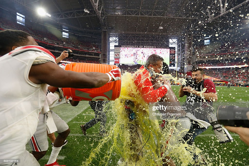 Wide receiver Michael Thomas #3 of the Ohio State Buckeyes (left) and running back Ezekiel Elliott #15 (right) douse head coach Urban Meyer (center) with Gatorade after the fourth quarter of the BattleFrog Fiesta Bowl at University of Phoenix Stadium on January 1, 2016 in Glendale, Arizona. The Ohio State Buckeyes beat the Notre Dame Fighting Irish 44-28.