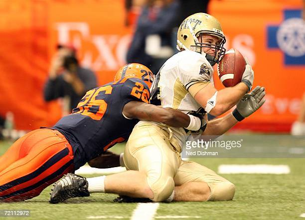 Wide receiver Mike Buches of the Pittsburgh Panthers makes a catch against Dowayne Davis of the Syracuse University Orange at the Carrier Dome on...