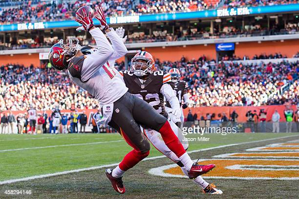 Wide receiver Mike Evans of the Tampa Bay Buccaneers catches a touchdown pass while under pressure from cornerback Buster Skrine of the Cleveland...