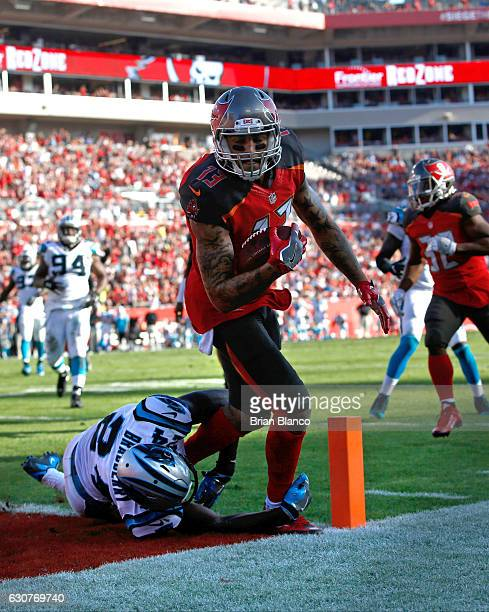 Wide receiver Mike Evans of the Tampa Bay Buccaneers hauls in a 10 yard pass from quarterback Jameis Winston for the touchdown while getting pressure...