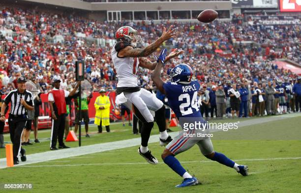 Wide receiver Mike Evans of the Tampa Bay Buccaneers hauls in a pass in front of cornerback Eli Apple of the New York Giants for a touchdown during...