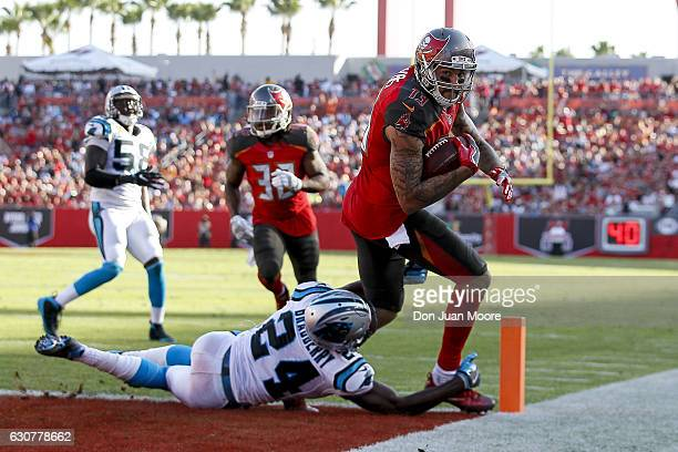 Wide receiver Mike Evans of the Tampa Bay Buccaneers scores the gamewinning touchdown catch over Cornerback James Bradberry of the Carolina Panthers...