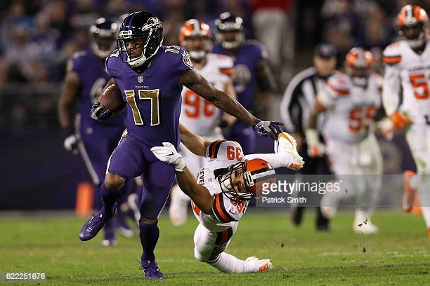 Wide receiver Mike Wallace of the Baltimore Ravens carries the ball against defensive back Ed Reynolds of the Cleveland Browns in the third quarter...