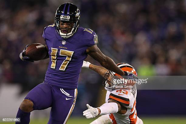 Wide receiver Mike Wallace of the Baltimore Ravens carries the ball past cornerback Joe Haden of the Cleveland Browns in the third quarter at MT Bank...