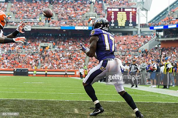 Wide receiver Mike Wallace of the Baltimore Ravens catches a 17 yard touchdown pass from quarterback Joe Flacco during the third quarter against the...