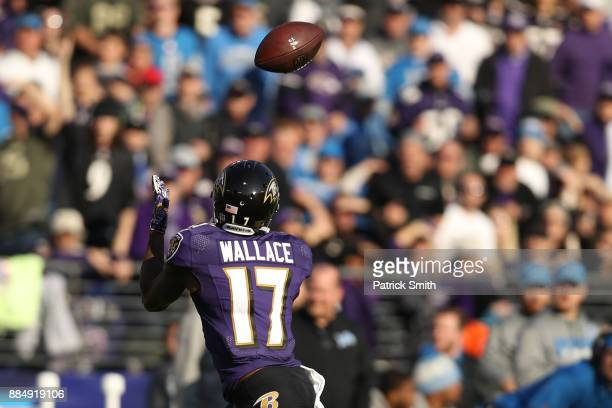 Wide Receiver Mike Wallace of the Baltimore Ravens catches a pass in the second quarter against the Detroit Lions at MT Bank Stadium on December 3...