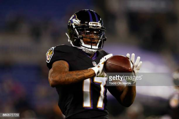 Wide Receiver Mike Wallace of the Baltimore Ravens catches the ball in warm ups prior to the game against the Houston Texans at MT Bank Stadium on...