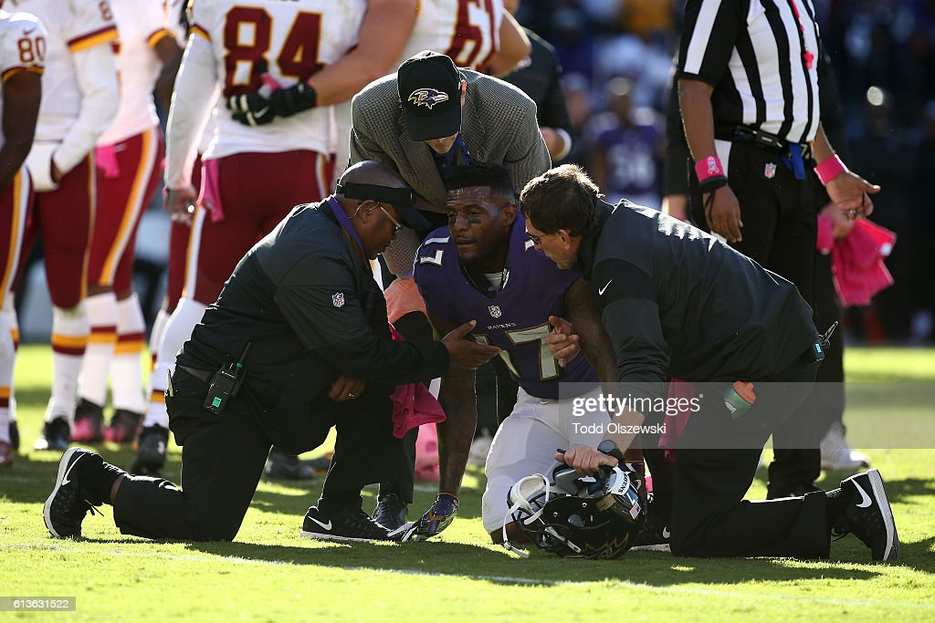Wide receiver Mike Wallace #17 of the Baltimore Ravens is attended to by trainers in the second half against the Washington Redskins at M&T Bank Stadium on October 9, 2016 in Baltimore, Maryland.