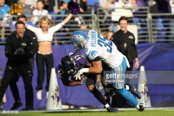 Wide Receiver Mike Wallace of the Baltimore Ravens is tackled by strong safety Miles Killebrew of the Detroit Lions in the second quarter at MT Bank...