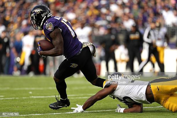 Wide receiver Mike Wallace of the Baltimore Ravens scores a first quarter touchdown past cornerback Artie Burns of the Pittsburgh Steelers in the...