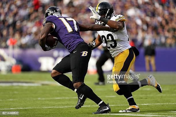 Wide receiver Mike Wallace of the Baltimore Ravens scores a first quarter touchdown past free safety Mike Mitchell of the Pittsburgh Steelers in the...
