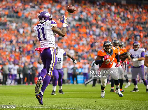 Wide receiver Mike Wallace of the Minnesota Vikings catches a pass for a second quarter touchdown against the Denver Broncos during a game at Sports...