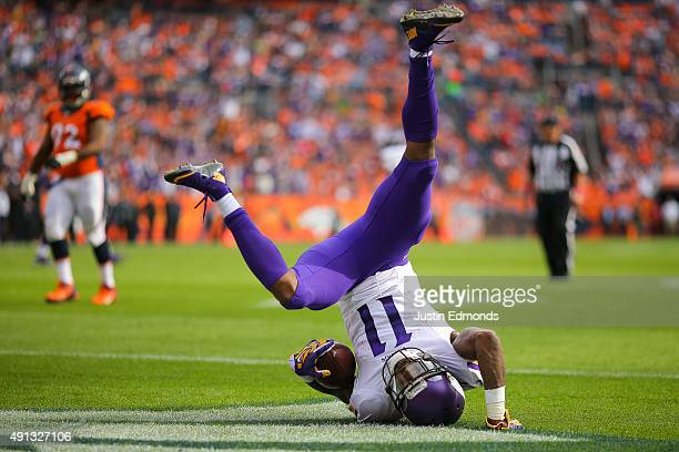Wide receiver Mike Wallace of the Minnesota Vikings falls into the end zone after catching a pass for a second quarter touchdown against the Denver...