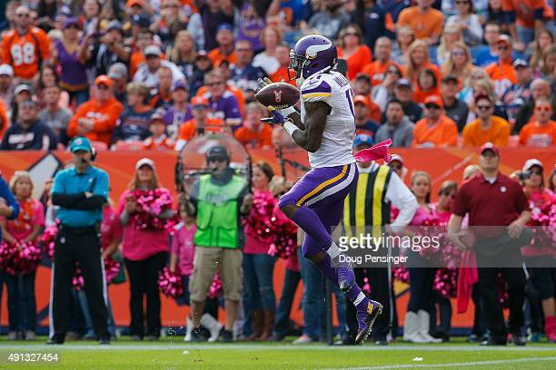 Wide receiver Mike Wallace of the Minnesota Vikings makes a catch for a second quarter touchdown against the Denver Broncos at Sports Authority Field...