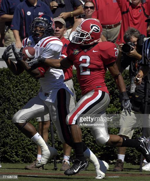 Wide receiver Mike Wallace of the Mississippi Rebels grabs a 45yard touchdown pass as cornerback Asher Allen defends for the Georgia Bulldogs on...