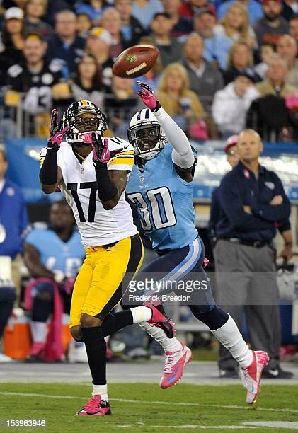 Wide receiver Mike Wallace of the Pittsburgh Steelers catches a touchdown pass over the outstretched arms of Jason McCourty of the Tennessee Titans...