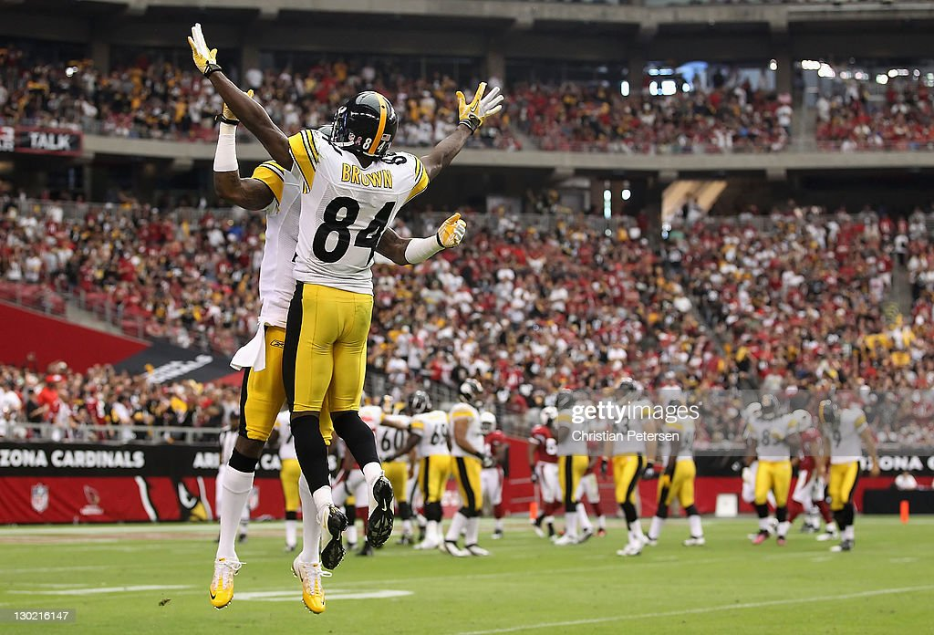 Wide receiver Mike Wallace #17 of the Pittsburgh Steelers celebrates with Antonio Brown #84 (L) after scoring on a 95 touchdown reception against the Arizona Cardinals during the second quarter of the NFL game at the University of Phoenix Stadium on October 23, 2011 in Glendale, Arizona. The Steelers defeated the Cardinals 32-20.