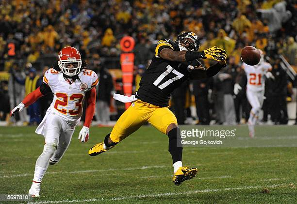 Wide receiver Mike Wallace of the Pittsburgh Steelers reaches for a pass as safety Kendrick Lewis of the Kansas City Chiefs looks on during a game...