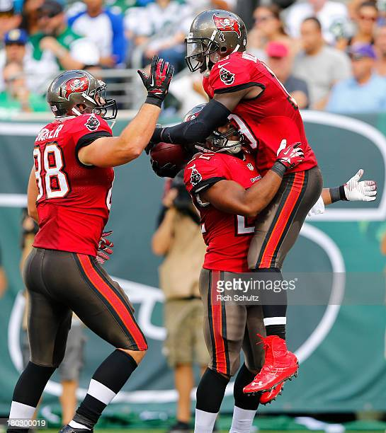 Wide receiver Mike Williams celebrates his first quarter touchdown with teammate running back Doug Martin and tight end Luke Stocker against the New...