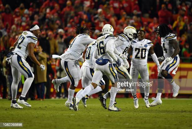 Wide receiver Mike Williams of the Los Angeles Chargers celebrates with teammates after catching a two point conversion with 4 seconds remaining in...