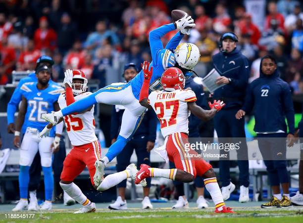 Wide receiver Mike Williams of the Los Angeles Chargers completes a pass over the defense of defensive back Rashad Fenton of the Kansas City Chiefs...