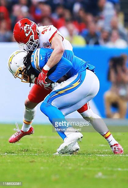 Wide receiver Mike Williams of the Los Angeles Chargers is tackled by defensive back Daniel Sorensen of the Kansas City Chiefs during the game at...