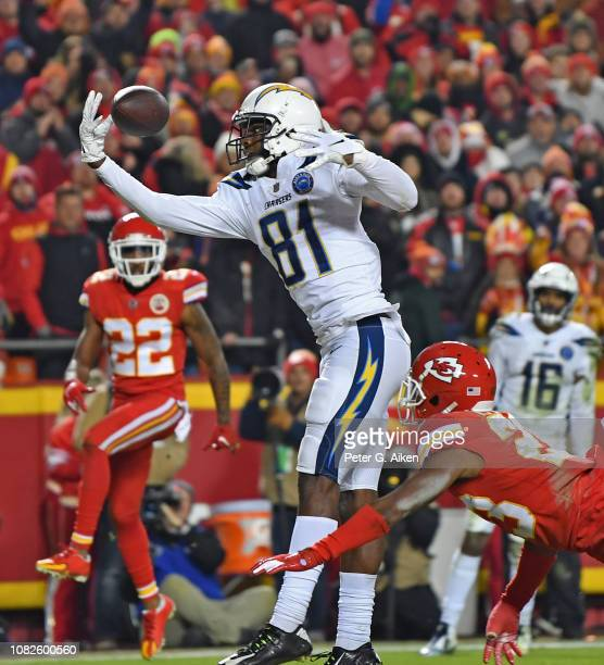 Wide receiver Mike Williams of the Los Angeles Chargers reaches out for a pass in the back of the end zone against cornerback Kendall Fuller of the...