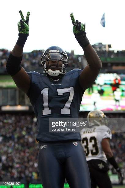 Wide receiver Mike Williams of the Seattle Seahawks reacts after catching a 38yard third quarter touchdown pass against the New Orleans Saints during...
