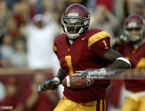 Wide receiver Mike Williams of the USC Trojans celebrates a touchdown reception against the Oregon State Beavers on December 6 2003 at the Los...