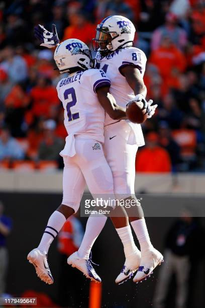Wide receiver Mikel Barkley celebrates a touchdown catch by tight end Pro Wells of the TCU Horned Frogs against the Oklahoma State Cowboys in the...