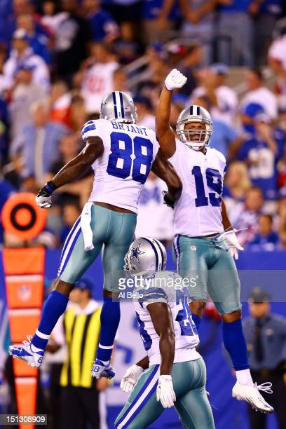 Wide receiver Miles Austin of the Dallas Cowboys celebrates after scoring a touchdown in the fourth quarter with teammate wide receiver Dez Bryant...