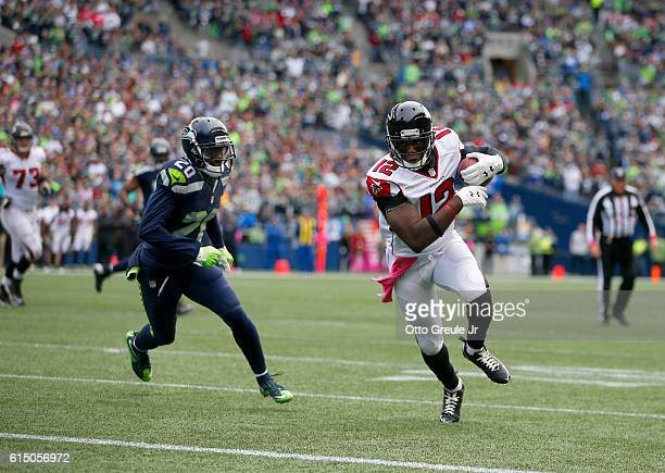 Wide receiver Mohamed Sanu of the Atlanta Falcons makes a reception against the defense of cornerback Jeremy Lane of the Seattle Seahawks at...