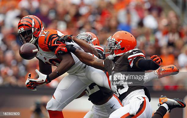 Wide receiver Mohamed Sanu of the Cincinnati Bengals has a pass knocked away by defensive backs Buster Skrine and TJ Ward of the Cleveland Browns at...