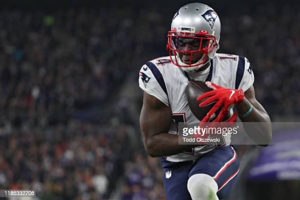 Wide receiver Mohamed Sanu of the New England Patriots scores a second quarter touchdown against the Baltimore Ravens at M&T Bank Stadium on November...