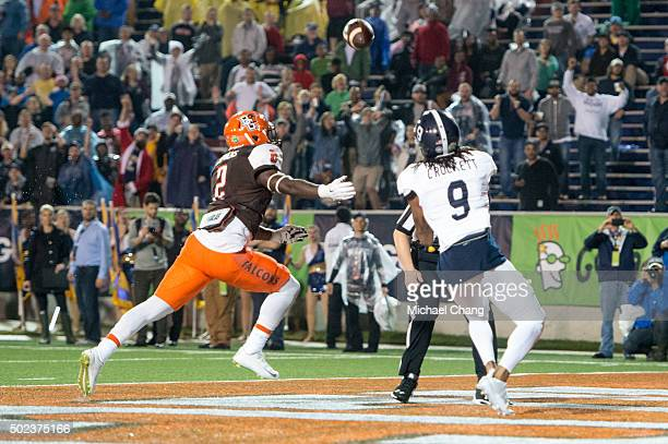 Wide receiver Montay Crockett of the Georgia Southern Eagles catches a pass in front of defensive back Clint Stephens of the Bowling Green Falcons on...
