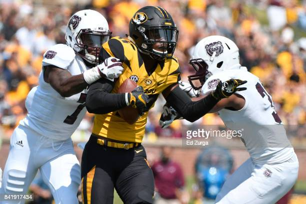 Wide receiver Nate Brown of the Missouri Tigers catches a pass against Tre Betts of the Missouri State Bears in the second quarter at Memorial...