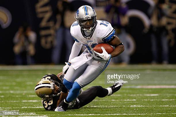 Wide receiver Nate Burleson of the Detroit Lions breaks a tackle by cornerback Jabari Greer of the New Orleans Saints at MercedesBenz Superdome on...